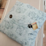 Vintage feather-filled linen cushion - £10